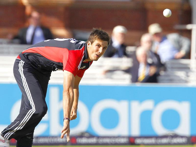 England's Steven Finn bowls during the fourth One Day International (ODI) cricket match between England and India at Lord's cricket ground in London.