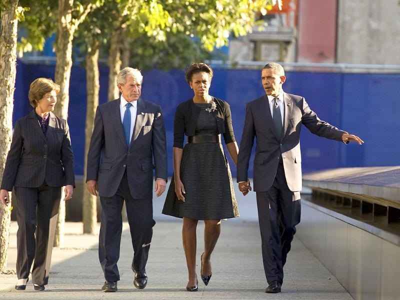 US President Barack Obama (R) First Lady Michelle Obama, former President George W Bush and former First Lady Laura Bush (L) at the memorial wall on the North Tower reflecting pool of the World Trade Center in New York.