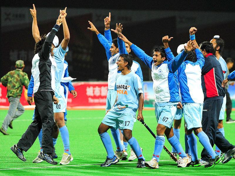 Players celebrate after defeating Pakistan, during their finals match at the first Asian Men's Hockey Championship in Ordos, in northern China's Inner Mongolia.