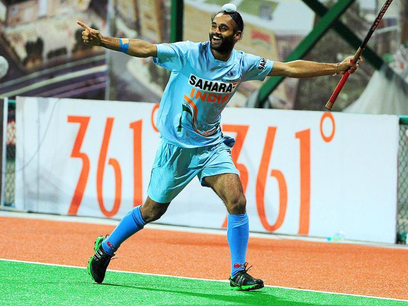 Saravanjit Singh celebrates after scoring the winning penalty shootout goal to defeat Pakistan, during their finals match at the first Asian Men's Hockey Championship in Ordos, in northern China's Inner Mongolia.
