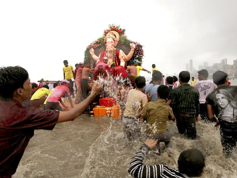 Devotees carry an idol of Hindu God Ganesh during a procession to immerse it in the Arabian Sea at the end of the ten day festival in Mumbai.