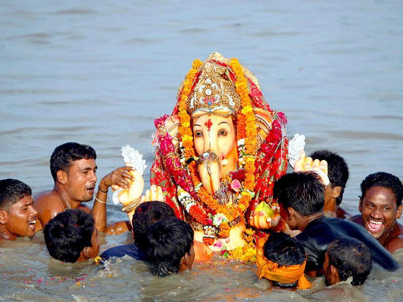 Devotees immerse an idol of Lord Ganesha to mark the end of 11 Days Ganesh festival in New Delhi on Sunday