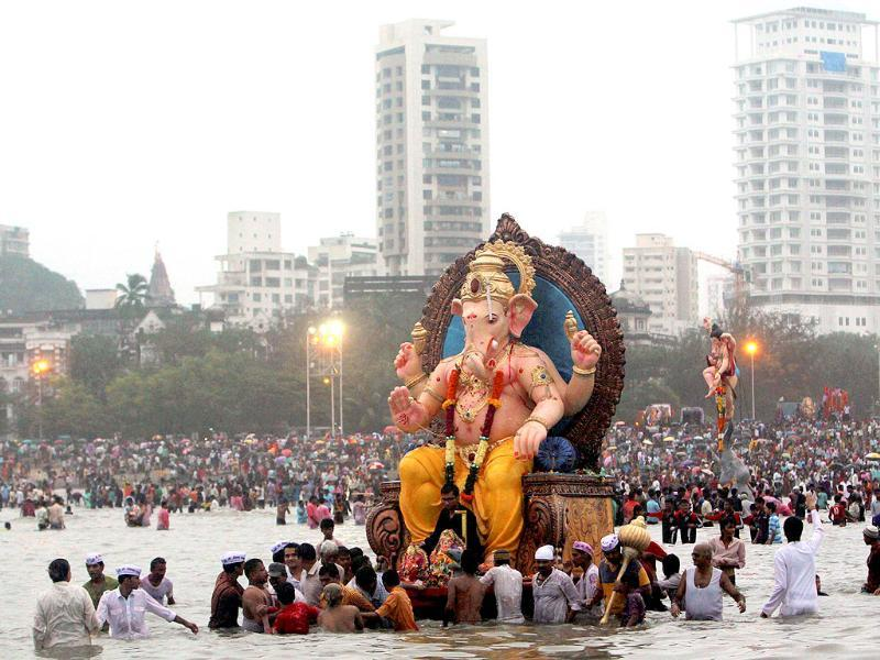 A large idol of Lord Ganesha being taken for immersion off Chowpatty beach on Sunday evening in Mumbai.