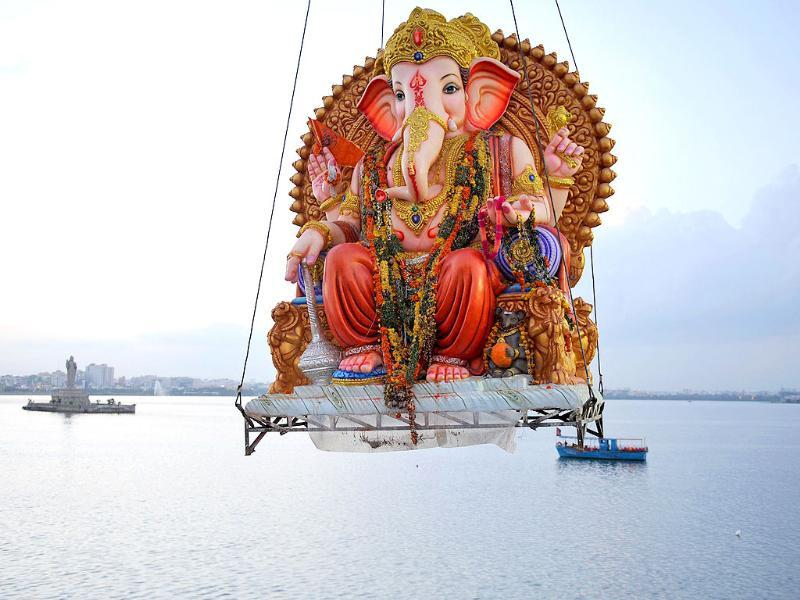 Hindu devotees prepare to immerse an idol of the Hindu God Ganesh into the Hussain Sagar Lake in Hyderabad.