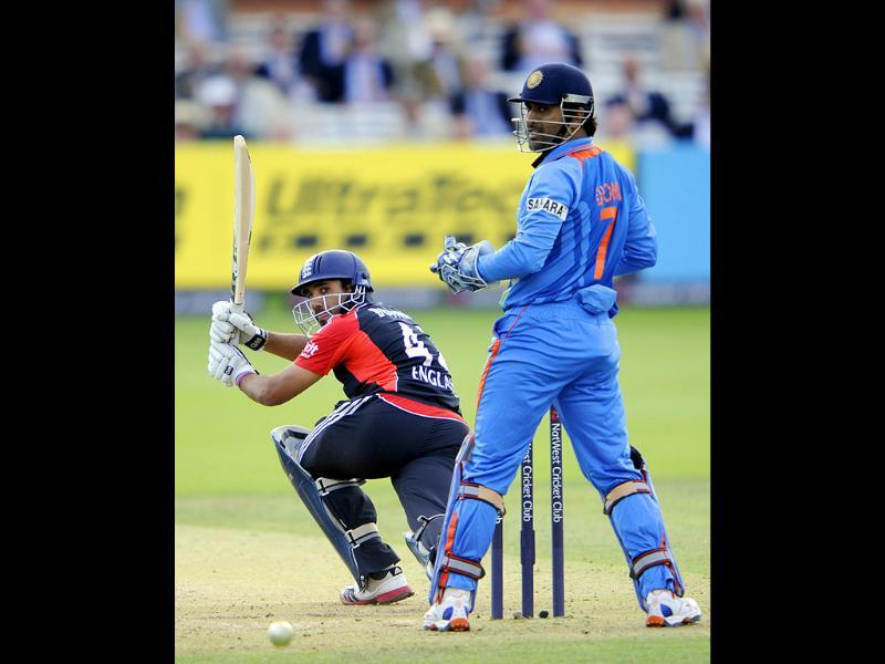 England's Ravi Bopara, left, guides a ball from India's Ravindra Jadeja, unseen, towards the boundary during their One Day International cricket match at Lord's cricket ground, London.