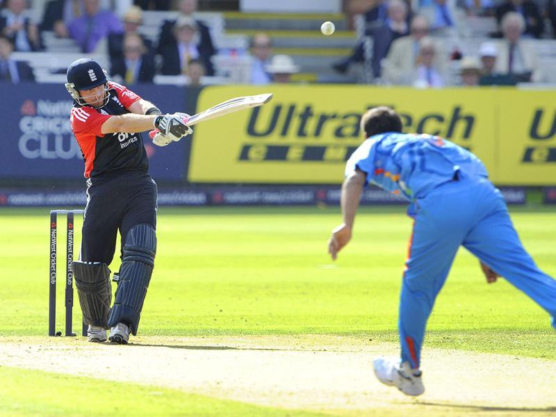 England's Ian Bell, left, hits a ball from India's Praveen Kumar, right, during their One Day International cricket match at Lord's cricket ground, London.