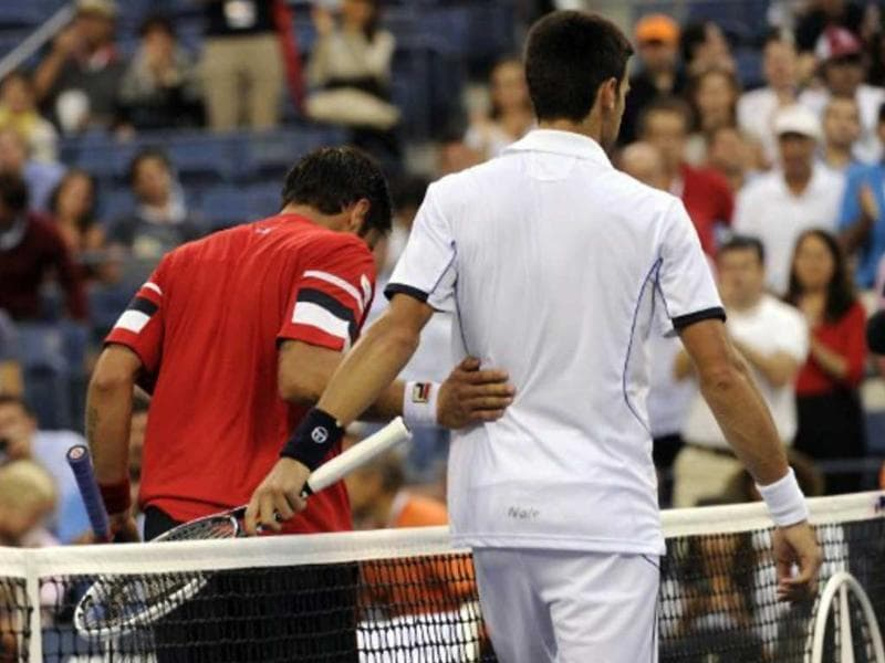 Novak Djokovic hugged it out with Davis Cup teammate Janko Tipsarevic after Tipsarevic withdrew in the 4th set in their US Open quarterfinal match, making way for Djokovic's semis clash with Federer.