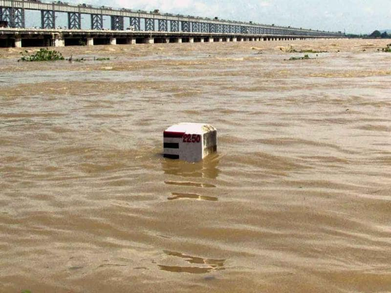 A view of the swollen Mahanadi river flowing above the danger mark near Mundali in Cuttack.