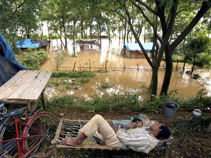 Villagers sleep near their temporary shelters after their homes were flooded by the rising waters of the River Mahanadi on the outskirts of Cuttack, about 30 kilometers from Bhubaneshwar.