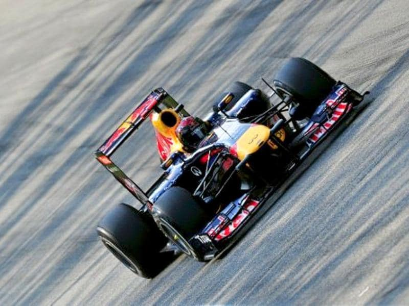Red Bull Racing's German driver Sebastian Vettel drives at the Autodromo Nazionale circuit on September 11, 2011 in Monza during the Formula One Italian Grand Prix.