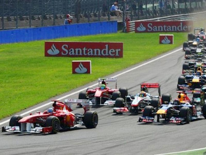 Ferrari's Spanish driver Fernando Alonso (L) leads after the start of the at the Autodromo Nazionale circuit on September 11, 2011 in Monza during the Formula One Italian Grand Prix.