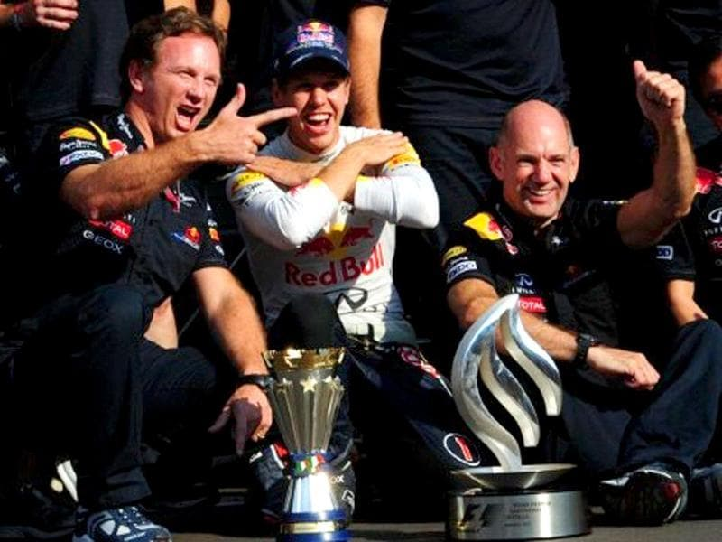 Red Bull Racing's German driver Sebastian Vettel (C) poses with his team after winning at the Autodromo Nazionale circuit on September 11, 2011 in Monza during the Formula One Italian Grand Prix.