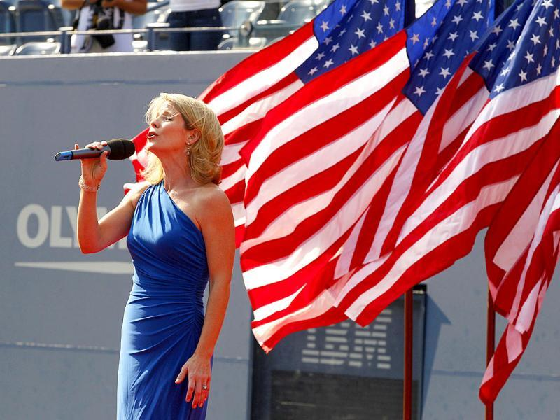 Kelli O'Hara sings the national anthem before the men's championship match between Rafael Nadal of Spain and Novak Djokovic of Serbia at the US Open tennis tournament.