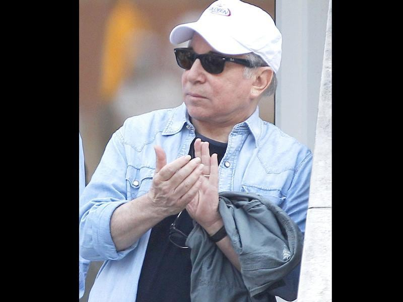 Paul Simon waits for the start of the men's championship match between Rafael Nadal of Spain and Novak Djokovic of Serbia at the US Open tennis tournament in New York.