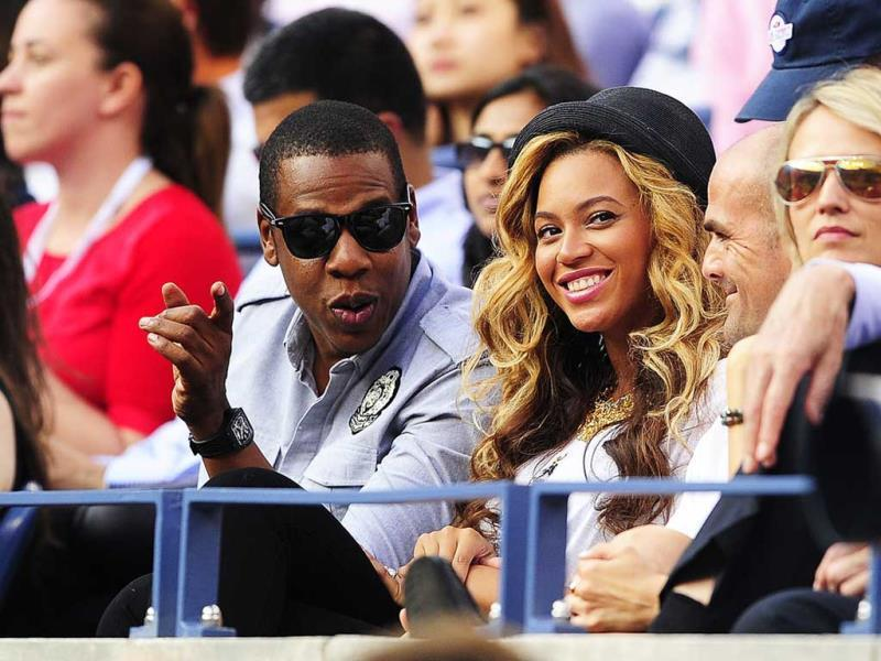 US singers Jay-Z and Beyonce watch Spanish tennis player Rafael Nadal play Serbia's Novak Djokovic in the men's US Open 2011 final at the USTA Billie Jean King National Tennis Center in New York.
