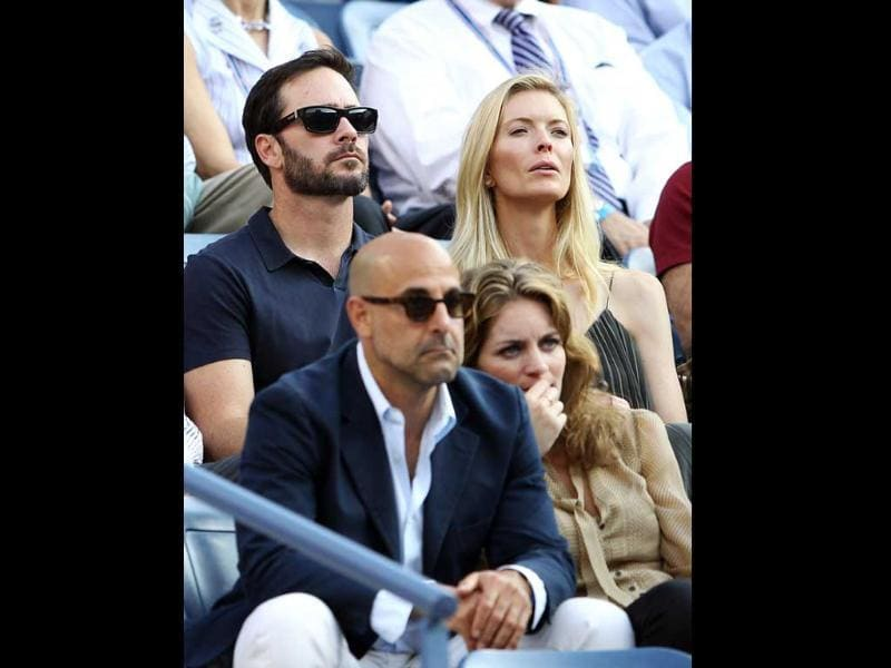 NASCR driver Jimmie Johnson and his wife Chandra watch Rafael Nadal of Spain play against Novak Djokovic of Serbia during the men's US Open final at the USTA Billie Jean King National Tennis Center in New York City.