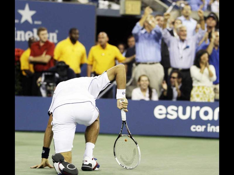 Novak Djokovic gets up after falling during the men's US Open 2011 final against Rafael Nadal.