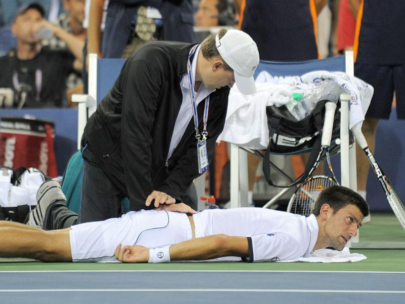 The Number one seed gets treatment from a trainer in the fourth set against number two seed Rafael Nadal during the men's US final match at the Billie Jean King National Tennis Center in New York.