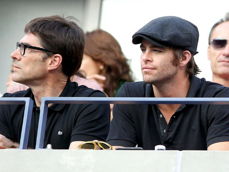 (L-R) Actors Thomas Gibson and Chris Pine watch Rafael Nadal versus Novak Djokovic US Open 2011 men's final at the USTA Billie Jean King National Tennis Center in New York City.