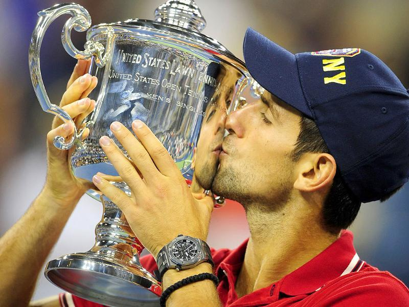 World No. 1 Novak Djokovic kisses the trophy after defeating Rafael Nadal in the men's US Open 2011 final at the USTA Billie Jean King National Tennis Center in New York. Djokovic won 6-2, 6-4, 6-7, 6-1.