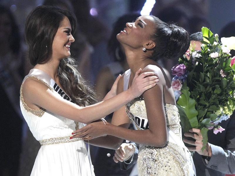 First runner up Miss Ukraine Olesia Stefanko congratulates Miss Angola Leila Lopes after she was named Miss Universe 2011.