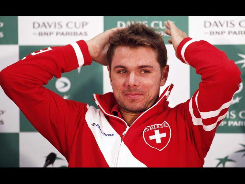 Stanislas Wawrinka of Switzerland gestures during the Davis Cup official news conference in Sydney.