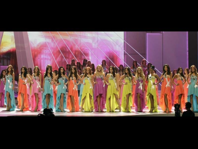 The sixteen finalists stand in line during the Miss Universe pageant in Sao Paulo, Brazil.