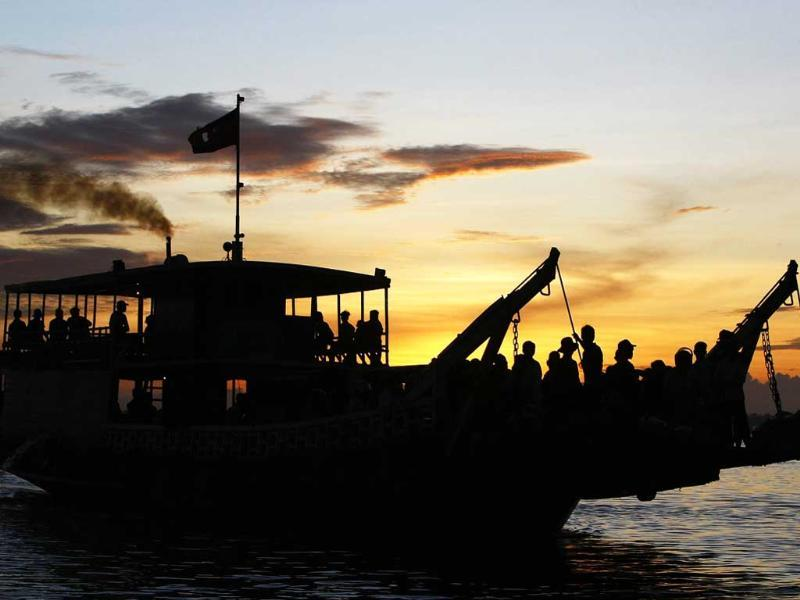 Cambodian passengers cross the Mekong river by ferry at a port in Phnom Penh, Cambodia.