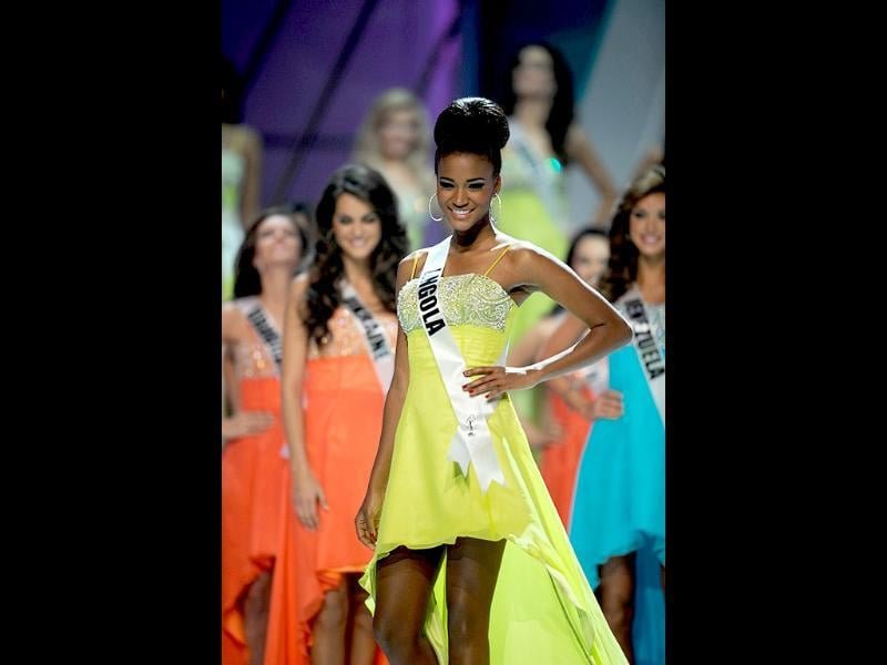 Miss Angola is seen in a lemon yellow dress as she participates in the the 60th Miss Universe beauty pageant.
