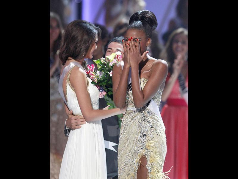Miss Angola Leila Lopes reacts as she hears the judges' decision choosing her as Miss Universe 2011 during the Miss Universe pageant in Sao Paulo September 12, 2011. With Miss Angola is Miss Ukraine Olesia Stefanko, chosen as runner-up.