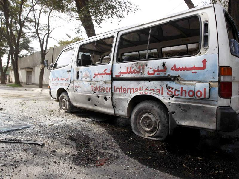 A damaged vehicle is seen after a rocket-propelled attack in Kabul.