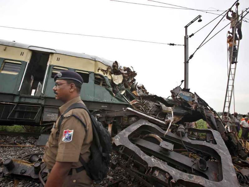 Wreckage of a derailed passenger train compartment lies on a railway track after two trains collided near Arakkonam, southwest of Chennai. The passenger train traveling through Tamil Nadu collided with another train stopped at a signal, killing eight people and injuring dozens more, a government official said.