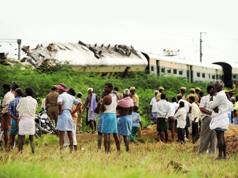 Onlookers gather around the wreckage of train carriages at Arakkonam, some 55 miles (90 kilometres) west of Chennai, after a crash between two trains in the state of Tamil Nadu. Indian railway officials have blamed driver error for a late-night collision between two passenger trains that killed nine people and injured more than 80. Emergency teams worked to clear the crash site, where five coaches were derailed in the impact. Southern Railway general manager Deepak Krishnan said initial investigations suggested the driver of the moving train, who survived the crash, had ignored speed restrictions and signal lights.