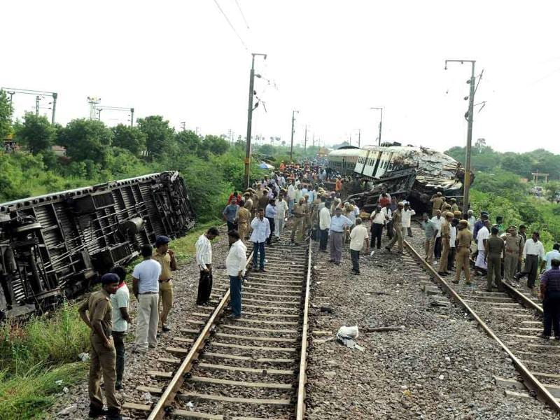 Railway officials, security personnel and onlookers gather around the wreckage of train carriages at Arakkonam, some 55 miles (90 kilometres) west of Chennai.