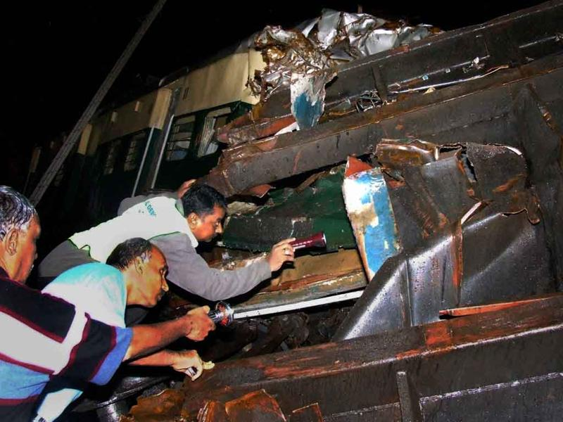 Rescuers search for survivors in the compartments of a train which met with an accident in Arakkonam on the outskirts of Chennai on the wee hours of Wednesday.