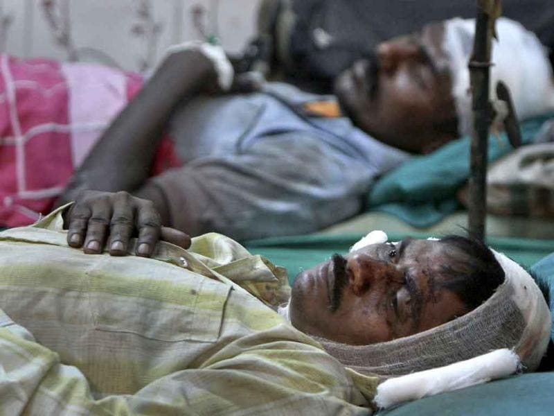 Men injured in a train collision lie in hospital beds after receiving treatment in Arakkonam, 80 km (50 miles) west of the of Chennai.