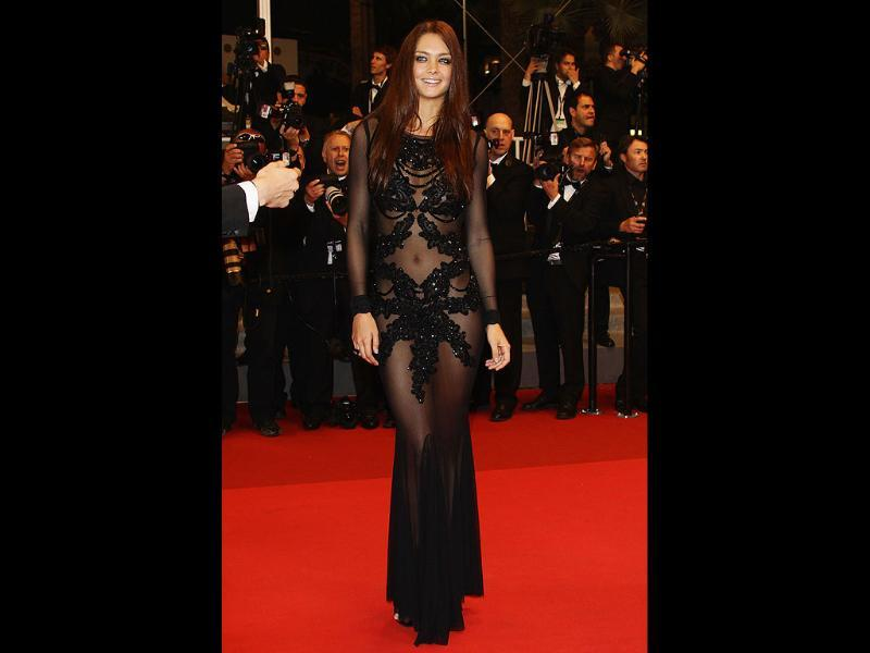Candice Boucher wears daring sheer black dress at Cannes film festival.