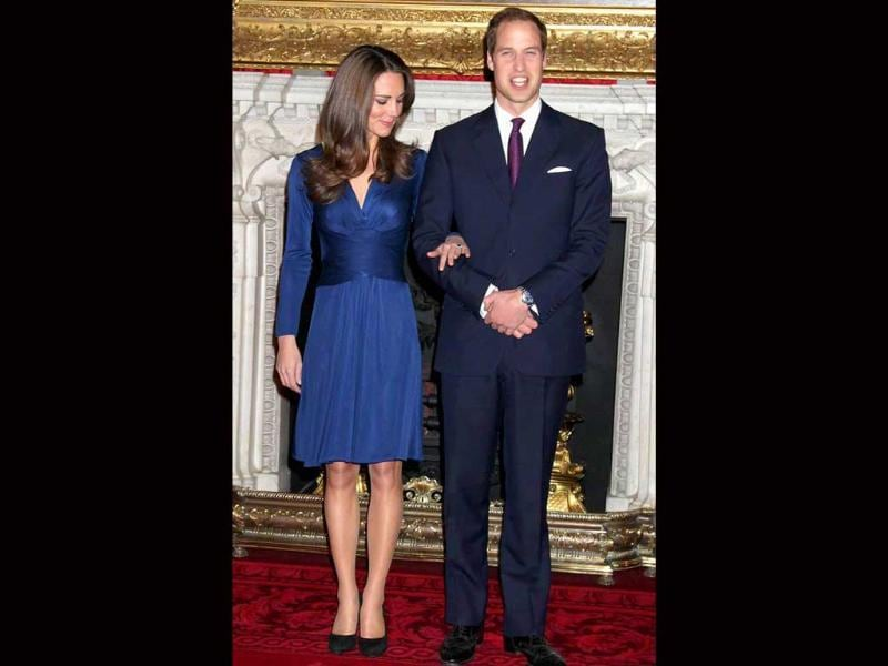 A blue Issa crossover knee-length dress that she wore when her engagement to William was announced, sold out within 24 hours and cheap knock-offs vanished almost instantly.