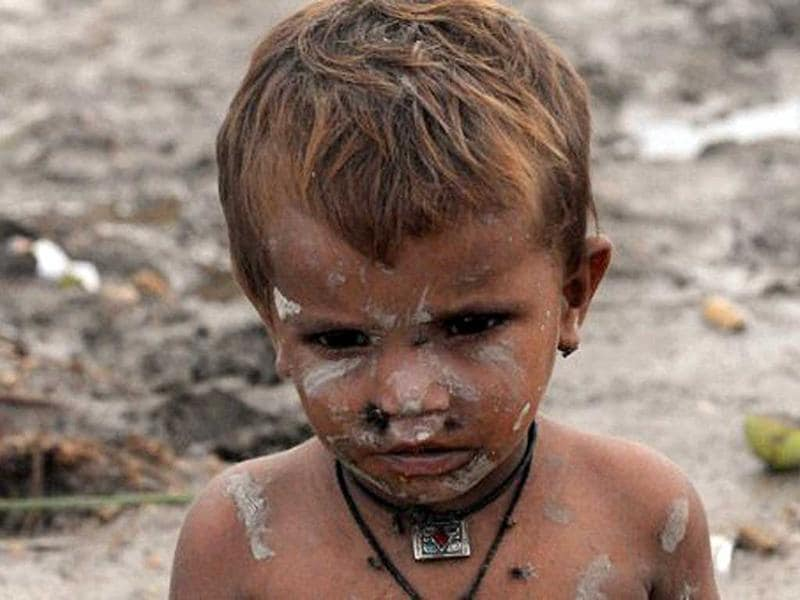 A Pakistani child stands in a flood affected evacuation camp at Golarchi town in Badin district, about 200 km east of Karachi.