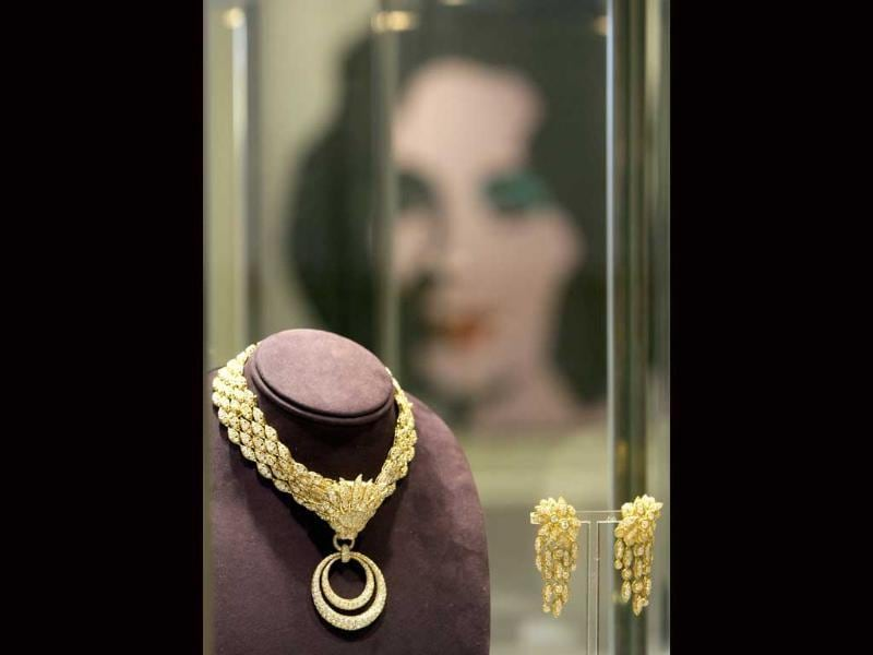The so called Grandmother's Necklace, left, and Grandmother's Earrings of Van Cleef Arpels from the Elizabeth Taylor collection are shown in Moscow's GUM department store at a pre-auction Christie's exhibition.