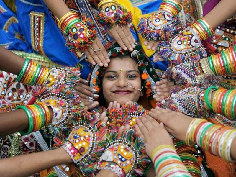 A folk dancer from the Zanzar Performing Arts poses with her troupe during a full dress rehearsal for the forthcoming Navratri festival.