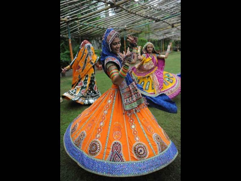 Indian folk dancers perform during a full dress rehearsal for the forthcoming Navratri festivities.