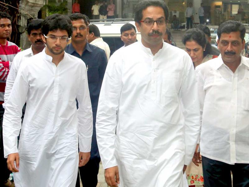 Politician Uddhav Thackeray arrives with his son.