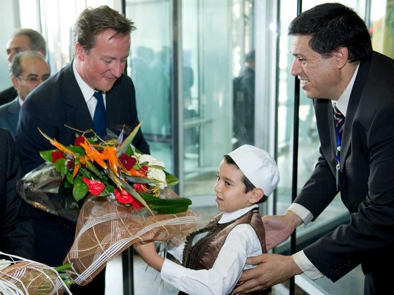 British Prime Minister David Cameron arrives at the Corinthia hotel in central Tripoli.