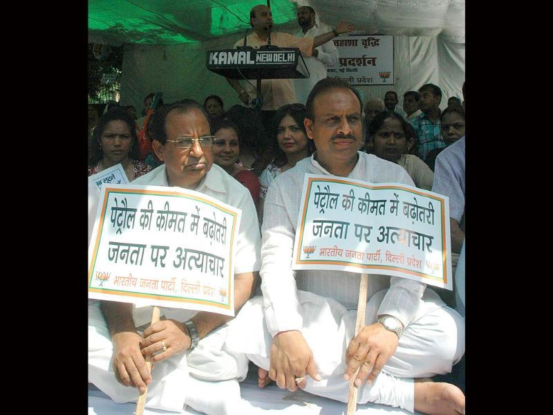 BJP activists participating in a dharna to protest against the price hike of petrol in New Delhi on Friday