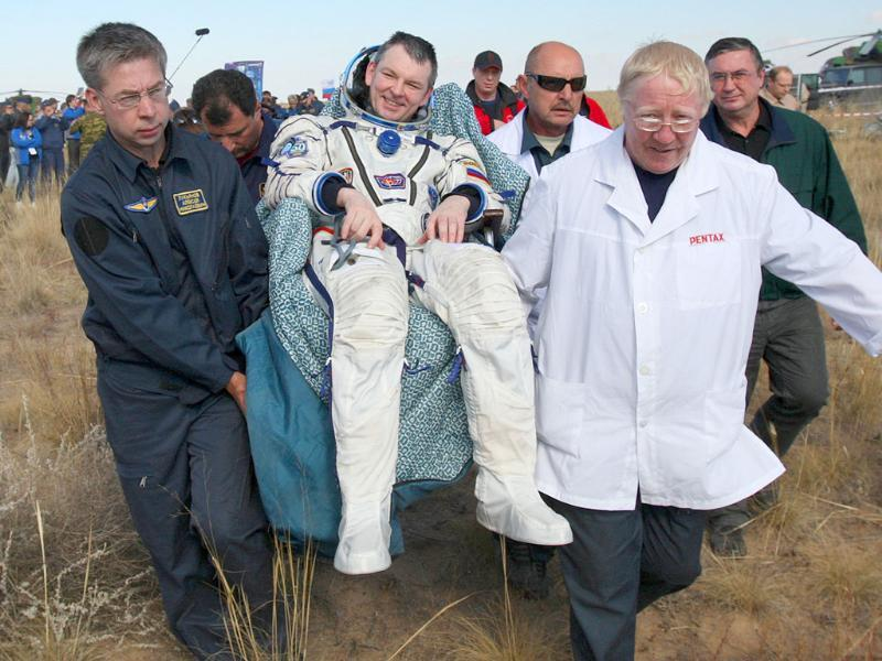 Russian space agency rescuers carry Russian cosmonaut Alexander Samokutyayev after his landing aboard the Soyuz TMA-21 space capsule about 150 km south-east of the Kazakh town of Dzhezkazgan.