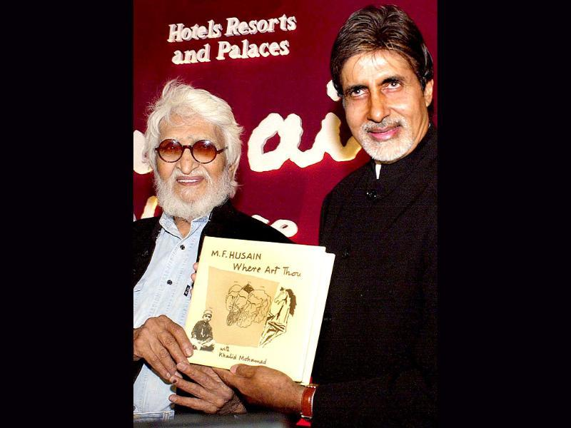 2002: Bollywood actor Amitabh Bachchan poses for the release of the autobiography of Maqbool Fida Hussain in Mumbai. (AFP)