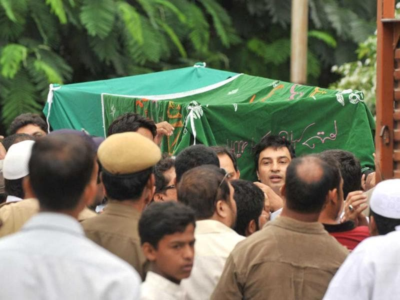 The coffin of Mohammad Ayazuddin, son of former Indian cricket captain and Moradabad MP Mohammad Azharuddin is seen during a funeral procession in Hyderabad.