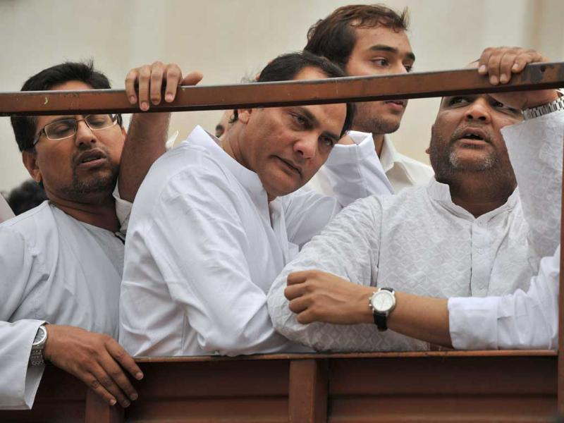 Former Indian cricket captain and Moradabad MP Mohammad Azharuddin and elder son Asaduddin are seen on board a truck during a funeral procession for his son Mohammed Ayazuddin in Hyderabad.
