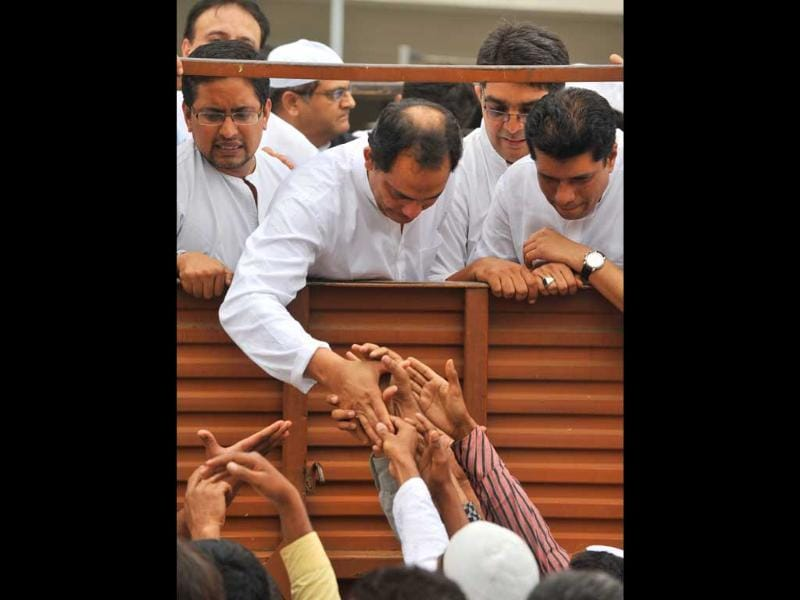 Mourners offer condolences to former Indian cricket captain and Moradabad MP Mohammad Azharuddin on board a truck during a funeral procession for his son Mohammed Ayazuddin in Hyderabad.